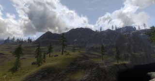Vue de loin et quelques sommets enneigés