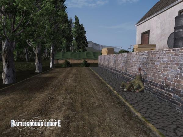 Soldat britannique mort contre un muret.